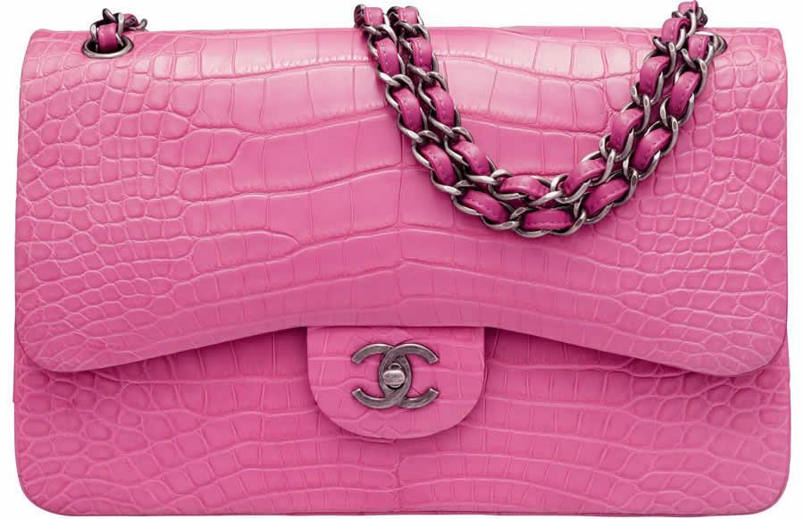 This authentic Chanel Matte Dark Pink Alligator Jumbo Classic Double Flap Bag (top) realized $20,000 at a June 2018 Heritage auction